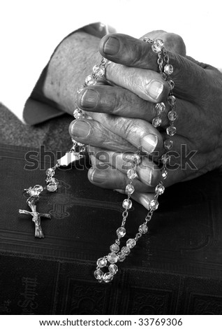 a close up view of praying hands - stock photo