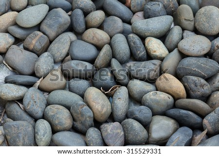 A close up view of smooth polished stones - stock photo