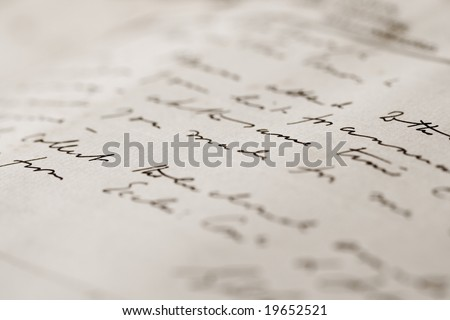 A close up with a narrow depth of field of a hand-written letter - stock photo