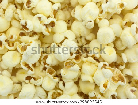 A close view of crunchy and delicious white cheddar cheese popcorn. - stock photo