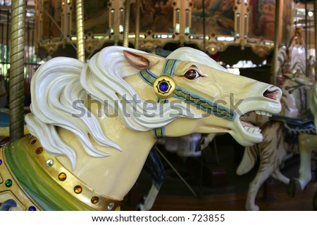 A close view of one of the painted horses on a merry-go-round ride.