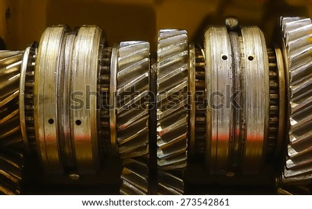 A close view of the gears and crankshafts of a vehicle transmission system  - stock photo