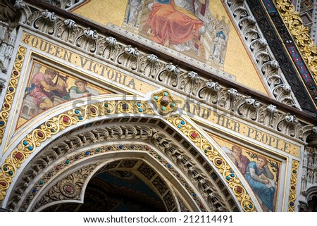 A close view of the mosaic and gold leaf detail on the front of the Albert Memorial in London's Kensington Gardens.