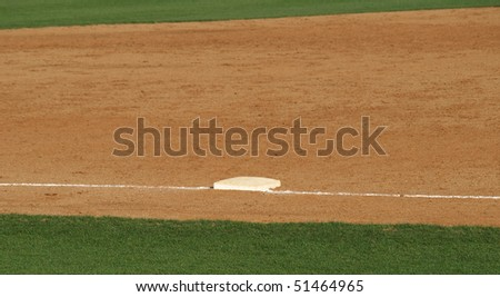 A close view of third base on a well kept infield - stock photo