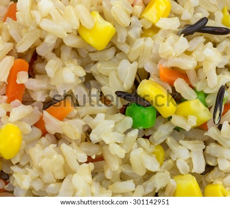A close view of wild rice and mixed vegetables. - stock photo