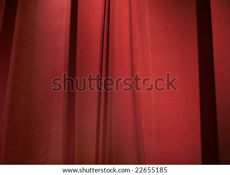 a closed dark red curtain on stage - stock photo