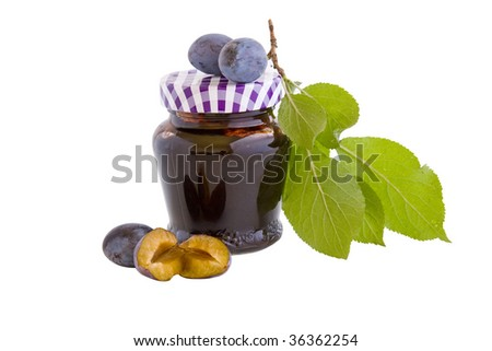 A closed glass of plum jam against white. File contains clipping path. - stock photo
