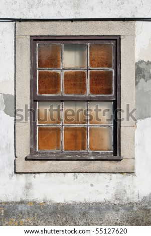 A closed old window with dirty glass. - stock photo