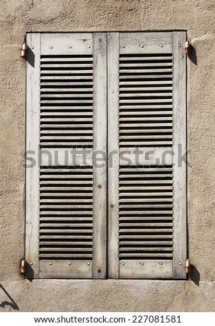 A closed old wooden window  - stock photo