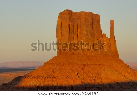 A closer view at Mitten glowing orange-red in setting sun in Monument Valley (Navajo Nation) - stock photo
