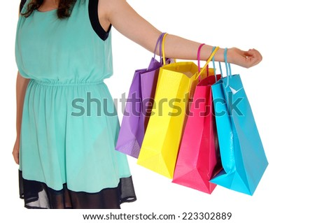 A closeup body part shot of a woman holding her colorful shopping bag's,  isolated on white background.