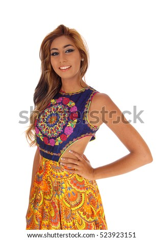 A closeup image of a beautiful young woman in a gorgeous dress