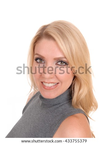 A closeup image of a lovely blond woman in a gray sweater, looking into