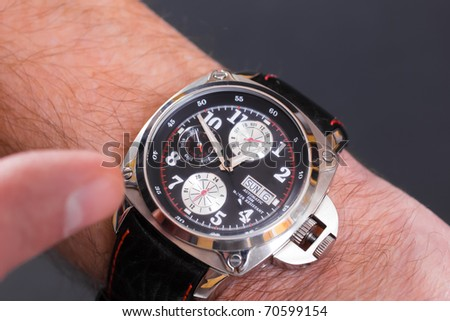 A closeup image of a man's wristwatch - stock photo