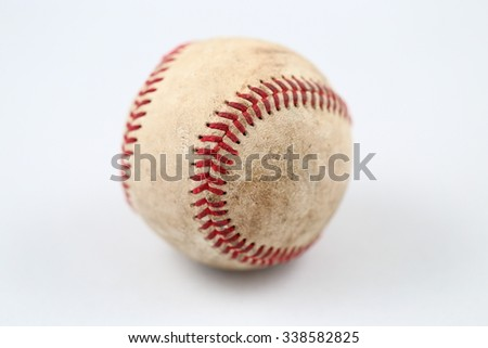 A closeup image of a used baseball on white background - stock photo