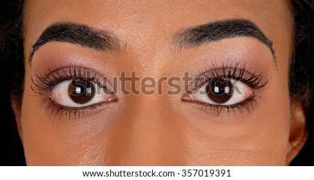 A closeup image of the big eye's of an African American woman. - stock photo