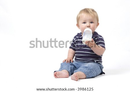 A closeup of a baby drinking a bottle of milk - stock photo