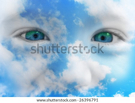 A closeup of a baby or toddler's face is showing through clouds in the sky. - stock photo