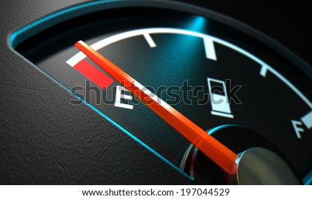 A closeup of a backlit illuminated gas gage with the needle indicating an empty tank on an isolated dark background - stock photo
