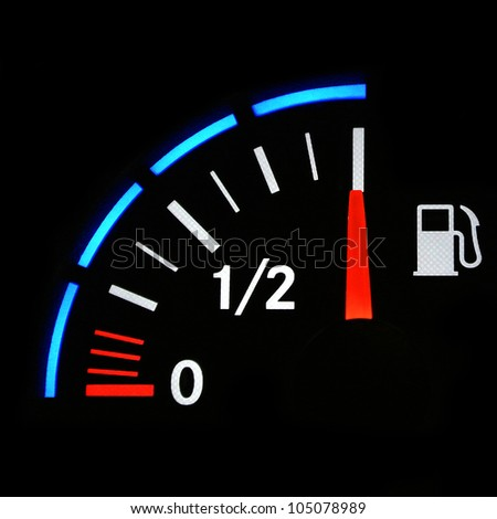 A closeup of a car fuel gauge