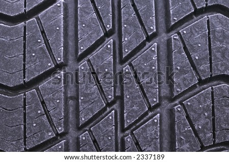 A closeup of a car tyre on a frosty morning - stock photo