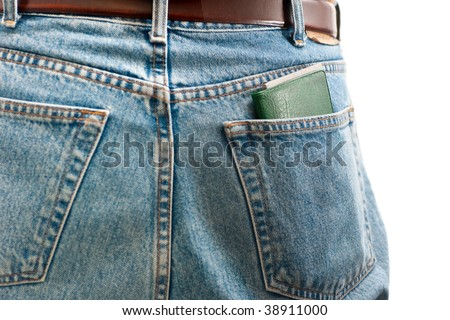 A closeup of a check book in the back pocket of blue jeans, isolated on white. - stock photo