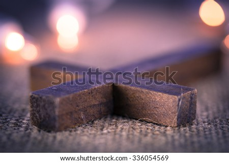 A closeup of a holy wooden Christian cross - stock photo