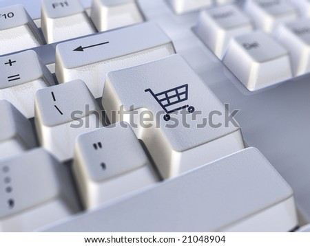 A closeup of a keyboard with the return key symbol replaced with a shopping cart icon to indicate e-commerce. - stock photo