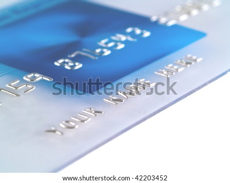 A closeup of a mock Credit Card with Your Name Here - stock photo