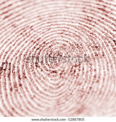 a closeup of a red fingerprint - shallow depth of field - stock photo
