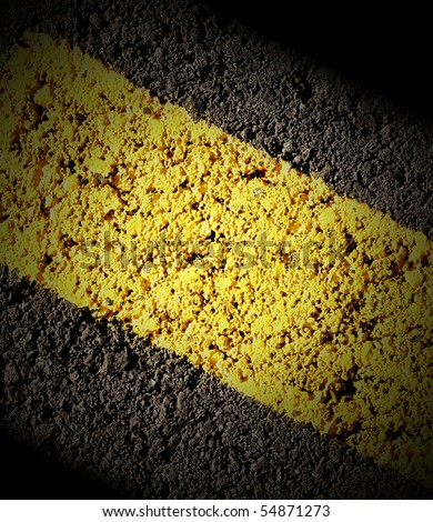 A closeup of a road with a yellow line divider. There is shadow and lots of texture for a background. Use the photo for a car, speed or travel theme. - stock photo