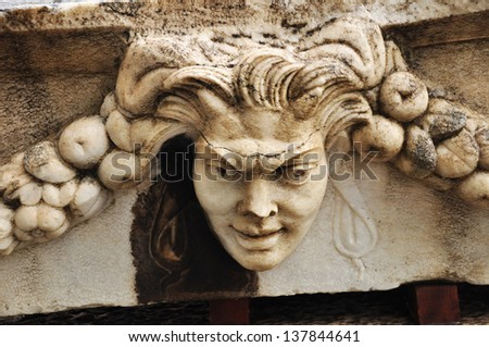 A Closeup of a stone relief. Beautiful relief work in stone and marble are seen on panels designed for burial caskets. Aphrodisias clearly loved sculpture and statues this is evident at the site.