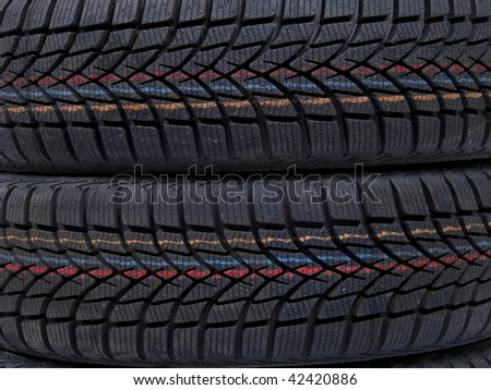 A closeup of a tread of a two tyres - stock photo