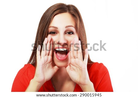 A closeup of a young girl shouting out over white background - stock photo