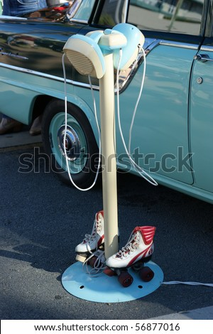 A closeup of american style drive-in movie speakers with rollerskates. - stock photo