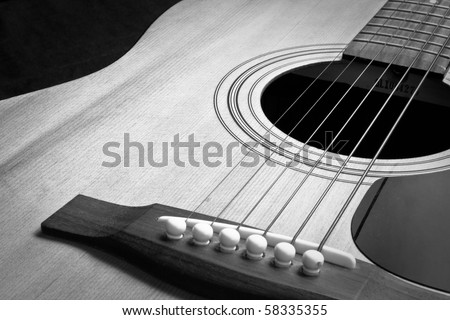 A closeup of an abstract classical acoustic guitar with strings - stock photo
