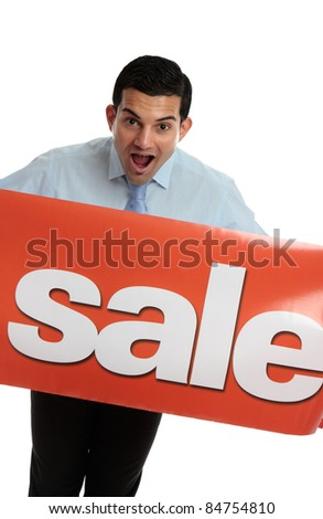 A closeup of an excited business or retail worker holding a red banner sign with Sale written on it. - stock photo