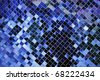 A closeup of an intricate and shiny blue glass mosaic wall. - stock photo
