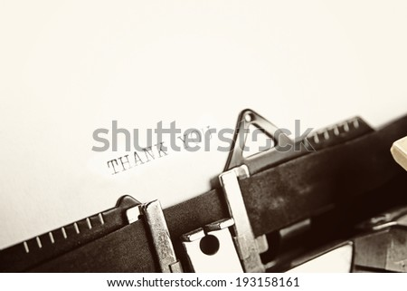 """A closeup of an old fashioned typewriter with the words """"THANK YOU"""" clearly visible. - stock photo"""