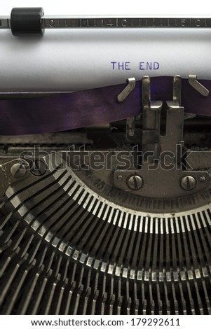 """A closeup of an old fashioned typewriter with the words """"THE END"""" - stock photo"""