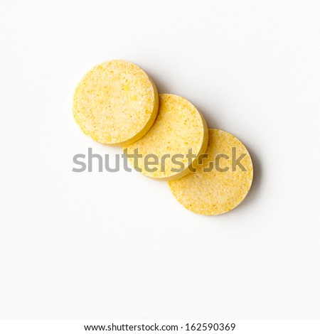 A closeup of an orange effervescent tablets - stock photo