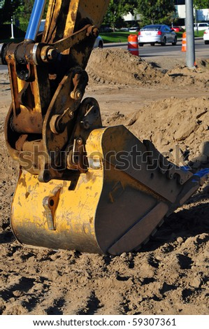 A closeup of digging bucket on hydraulic power equipment