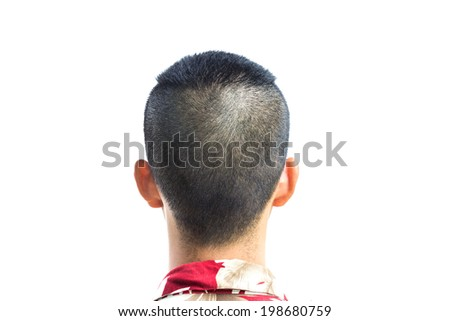 A closeup of the back of a young mans head and neck isolated over a white background.