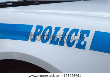 A closeup of the body of the police car with a sign POLICE. - stock photo