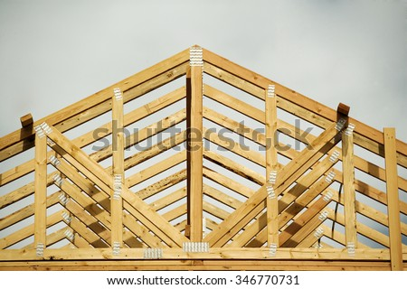 A closeup of the gable on a stick built home under construction. - stock photo