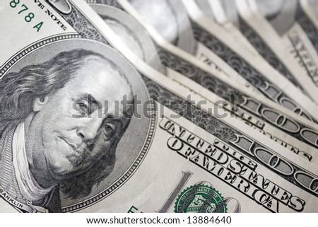 A closeup of the new 100 dollar bill picturing Benjamin Franklin.  It's all about the Benjamins.  Shallow depth of field.