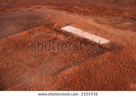 A closeup of the rubber on the pitchers mound. - stock photo