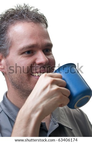 A closeup of the upper body of a man, ready to take a drink from his coffee cup, isolated on white.