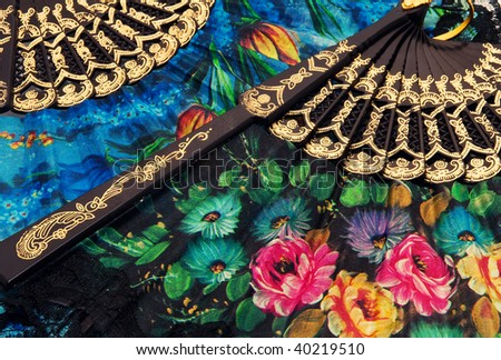 A closeup of two colorful fans - stock photo