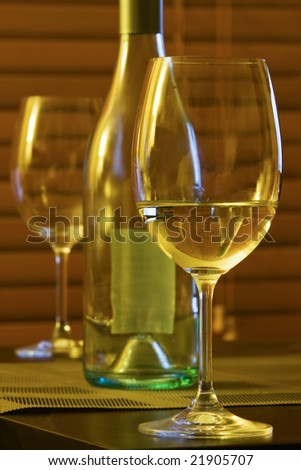 A closeup of wine glasses and bottle - stock photo